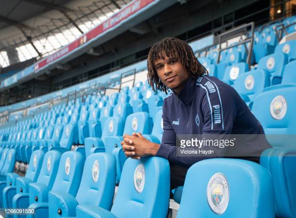 Nathan Ake poses as he is unveiled as Manchester City's new signing at Etihad Stadium on August 05, 2020 in Manchester, England.