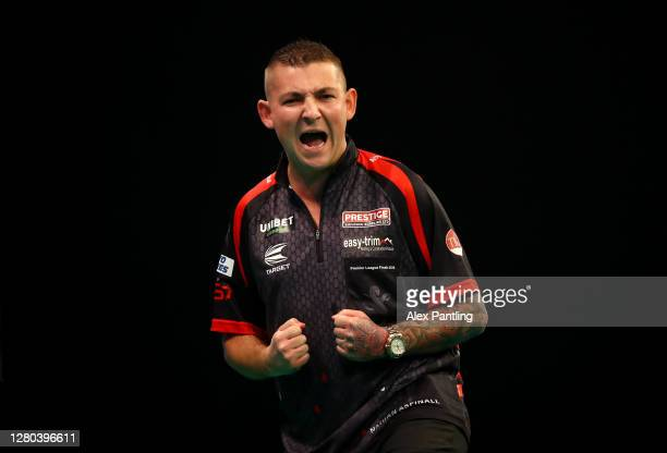 Nathan Aspinall of England celebrates during his semi-final match against Peter Wright of Scotland during the Unibet Premier League Play-Offs at...