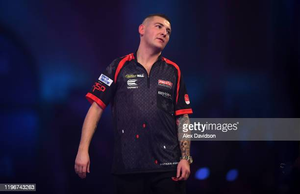 Nathan Aspinall reacts during the Semi-Final match between Michael van Gerwen and Nathan Aspinall on Day 15 of the 2020 William Hill World Darts...
