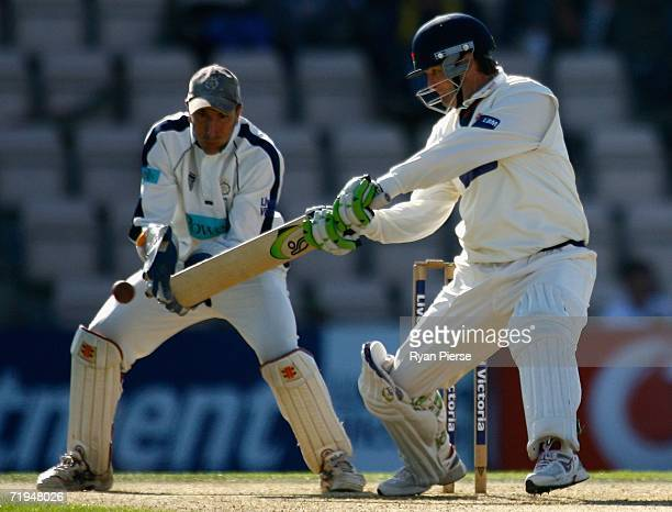 Nathan Astle of Lancashire plays a cut shot as Nic Pothas of Hampshire keeps wicket during day one of the Liverpool Victoria Insurance County...