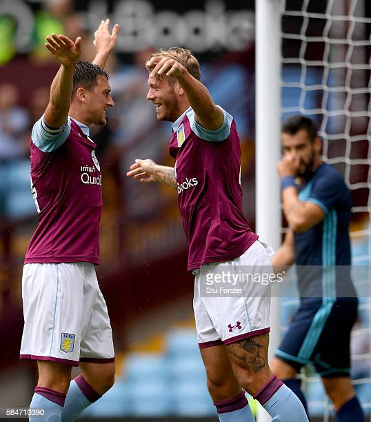 Nathan Baker celebrates with Tommy Elphick of Villa after scoring the opening goal during the pre season friendly between Aston Villa and...