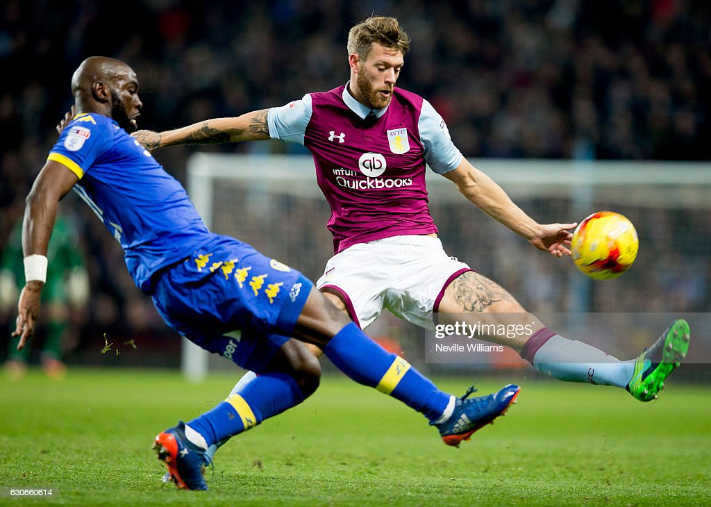 Nathan Baker of Aston Villa is challenged by Souleymane Doukara of Leeds United during the Sky Bet Championship match between Aston Villa and Leeds United at Villa Park on December 29, 2016 in Birmingham, England.