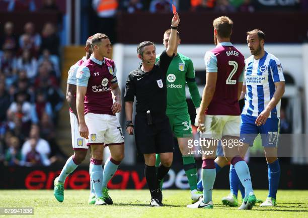 Nathan Baker of Aston Villa is sent off by referee Steve Martin during the Sky Bet Championship match between Aston Villa and Brighton Hove Albion at...