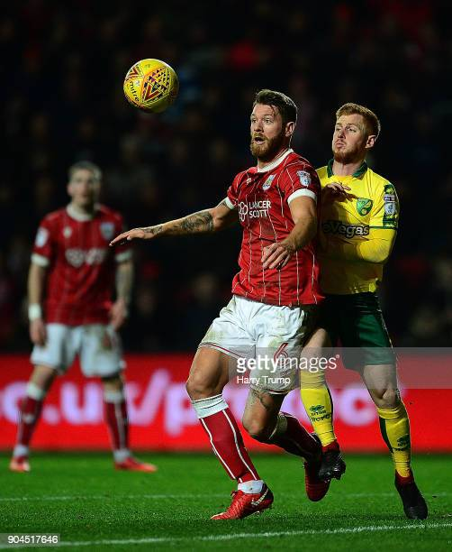 Nathan Baker of Bristol City is tackled by Harrison Reed of Norwich City during the Sky Bet Championship match between Bristol City and Norwich City...