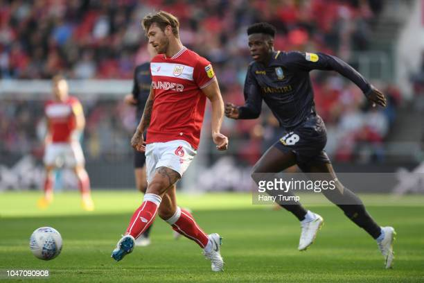 Nathan Baker of Bristol City passes the ball under pressure from Lucas Joao of Sheffield Wednesday during the Sky Bet Championship match between...