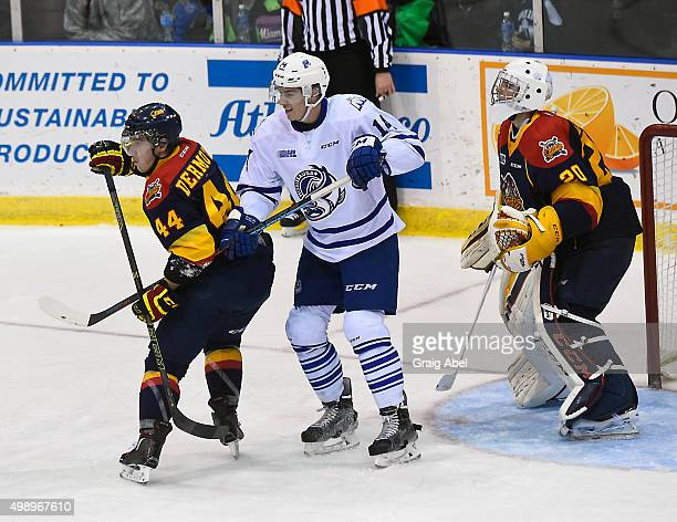 Nathan Bastian of the Mississauga Steelheads battles for space with Travis Dermott of the Erie Otters in front of Otter's goalie Jake Lawr during OHL...