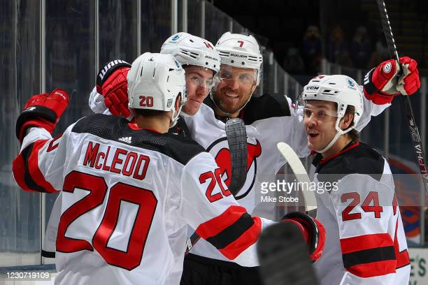 Nathan Bastian of the New Jersey Devils is congratulated by Michael McLeod, Matt Tennyson and Ty Smith after scoring a goal against the New York...