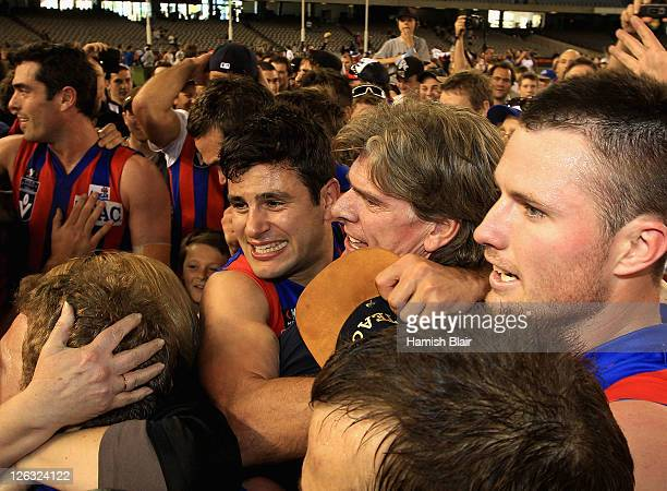 Nathan Batsanis of Port Melbourne celebrates with coach Gary Ayres after the VFL Grand Final match between Port Melbourne and Williamstown at Etihad...