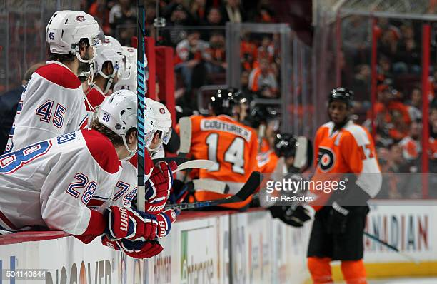 Nathan Beaulieu and Mark Barberio of the Montreal Canadiens look on with their teammates from the bench against the Philadelphia Flyers on January 5...