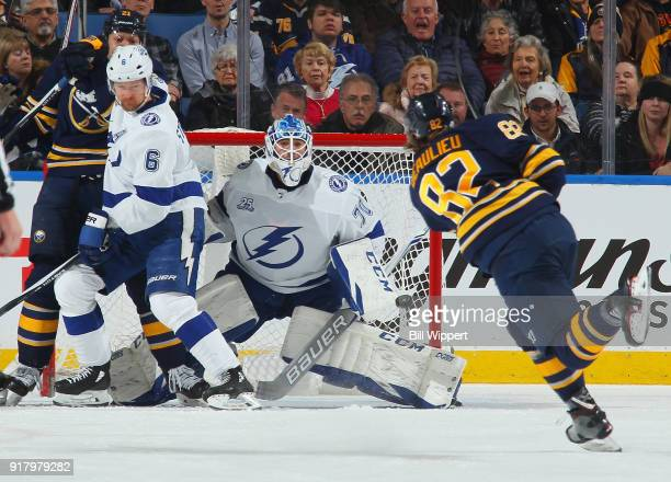 Nathan Beaulieu of the Buffalo Sabres fires a second period shot towards Louis Domingue of the Tampa Bay Lightning during an NHL game on February 13...