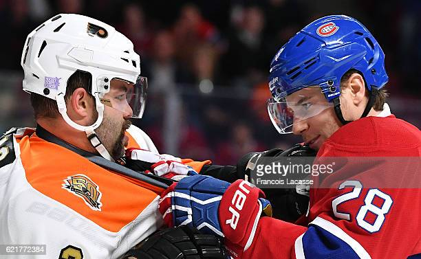 Nathan Beaulieu of the Montreal Canadiens and Radko Gudas of the Philadelphia Flyers exchanges words in the NHL game at the Bell Centre on November 5...