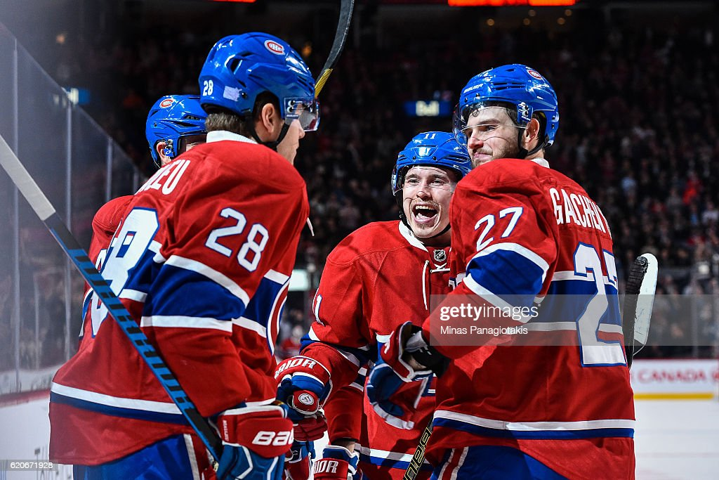 Nathan Beaulieu #28 of the Montreal Canadiens celebrates his goal with teammates Alex Galchenyuk #27 and Brendan Gallagher #11 during the NHL game at the Bell Centre on November 2, 2016 in Montreal, Quebec, Canada.