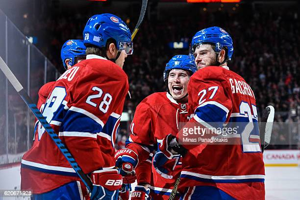 Nathan Beaulieu of the Montreal Canadiens celebrates his goal with teammates Alex Galchenyuk and Brendan Gallagher during the NHL game at the Bell...