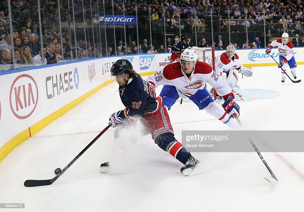 Nathan Beaulieu #28 of the Montreal Canadiens checks Mats Zuccarello #36 of the New York Rangers at Madison Square Garden on November 25, 2015 in New York City.