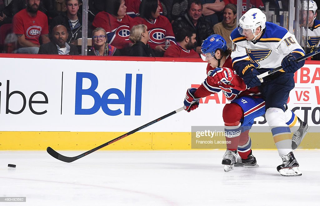 Nathan Beaulieu #28 of the Montreal Canadiens controls the puck while being challenged by Scottie Upshall #10 of the St-Louis Blues in the NHL game at the Bell Centre on October 20, 2015 in Montreal, Quebec, Canada.