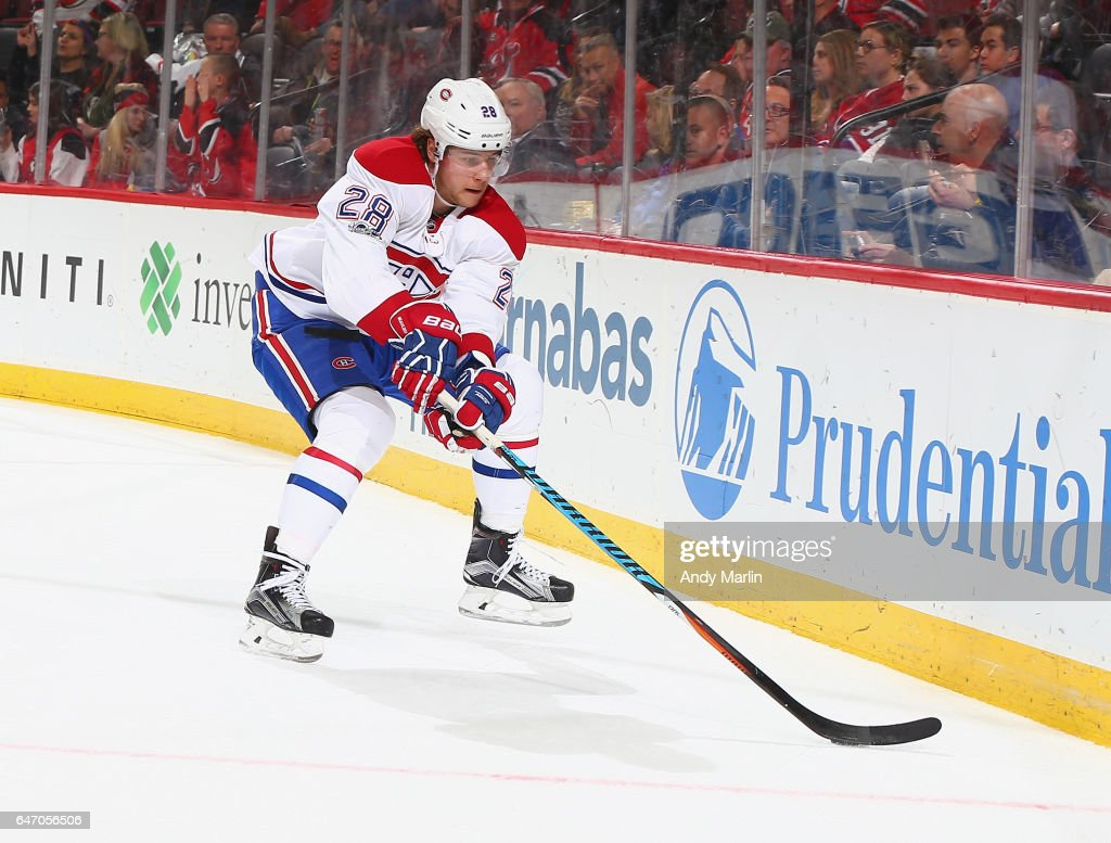 Nathan Beaulieu #28 of the Montreal Canadiens plays the puck against the New Jersey Devils during the game at Prudential Center on February 27, 2017 in Newark, New Jersey.