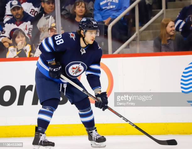Nathan Beaulieu of the Winnipeg Jets gets set during a first period faceoff against the Boston Bruins at the Bell MTS Place on March 14 2019 in...