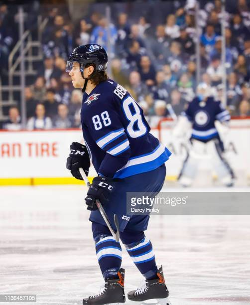 Nathan Beaulieu of the Winnipeg Jets keeps an eye on the play during second period action against the San Jose Sharks at the Bell MTS Place on March...