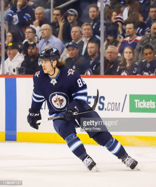 Nathan Beaulieu of the Winnipeg Jets keeps an eye on the play during first period action against the San Jose Sharks at the Bell MTS Place on March...