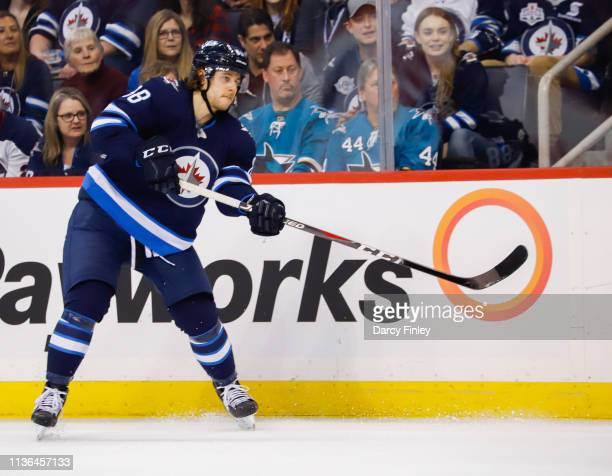 Nathan Beaulieu of the Winnipeg Jets keeps an eye on the play during third period action against the San Jose Sharks at the Bell MTS Place on March...