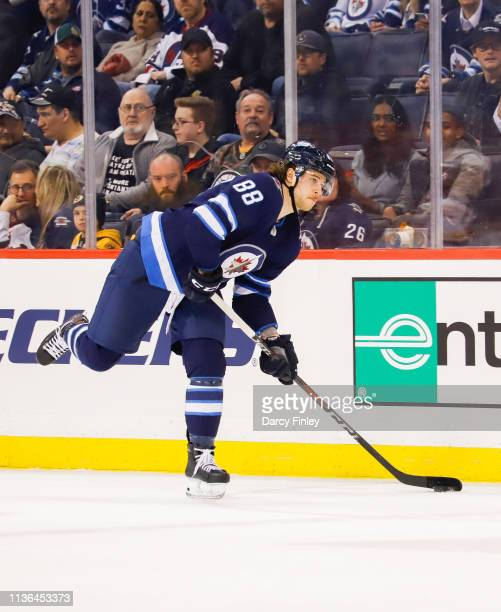 Nathan Beaulieu of the Winnipeg Jets plays the puck down the ice during first period action against the Boston Bruins at the Bell MTS Place on March...
