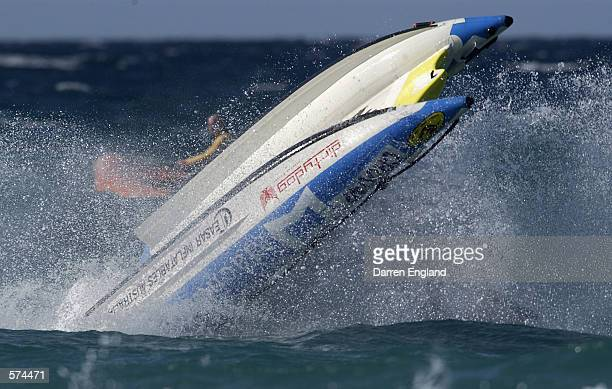 Nathan Berry and Chris Bortis of Australia flip their Thundercat Boat during racing at the Gold Coast Thundercat Club at Palm Beach on the Gold Coast...