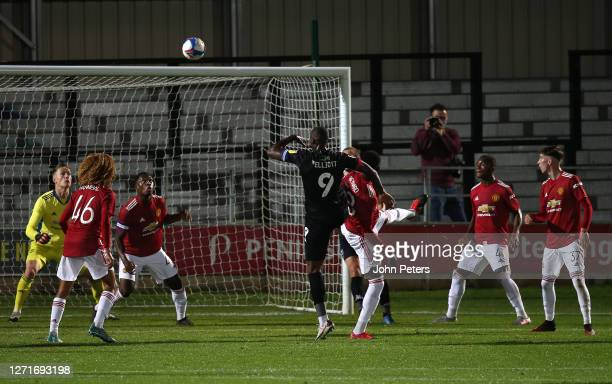 Nathan Bishop and Teden Mengi of Manchester United U21s in action during the EFL Trophy match between Salford City and Manchester United U21s at Moor...
