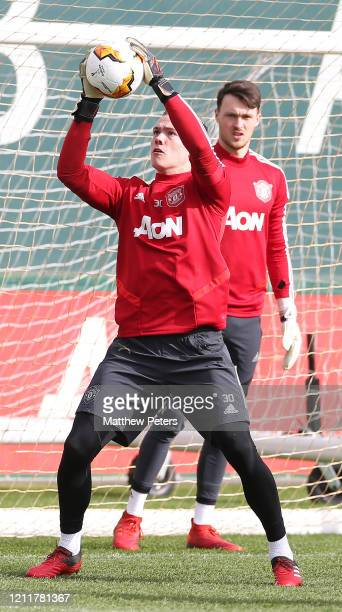 Nathan Bishop of Manchester United in action during a first team training session at Aon Training Complex on March 11 2020 in Manchester England