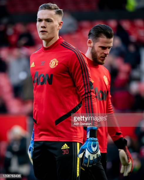 Nathan Bishop of Manchester United warms up ahead of the Premier League match between Manchester United and Watford FC at Old Trafford on February 23...
