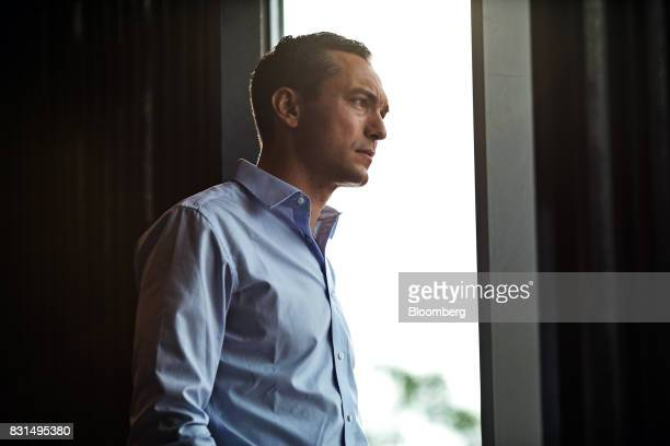 Nathan Blecharczyk cofounder and chief technology officer of Airbnb Inc poses for a photograph following a Bloomberg Television interview in...