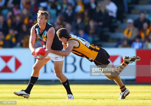 Nathan Blee of the Power is tackled by Clinton Young of the Hawks during the round 20 AFL match between the Hawthorn Hawks and the Port Adelaide...