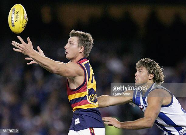 Nathan Bock for the Crows competes for the ball against Jess Sinclair for the Kangaroos during the round seventeen AFL match between The Kangaroos...