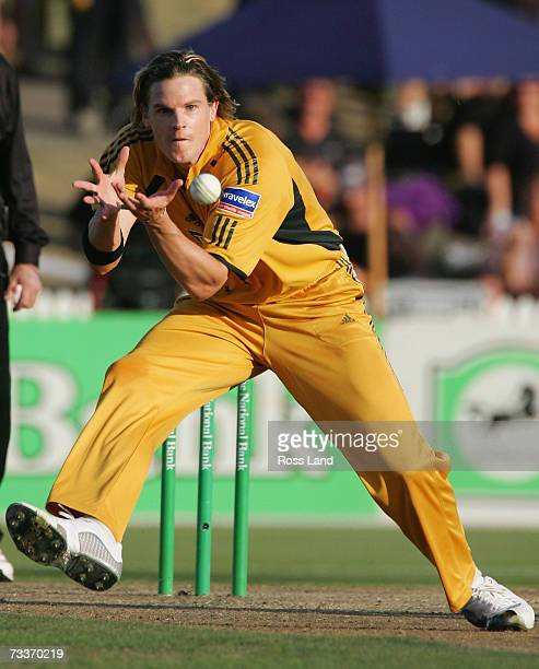 Nathan Bracken of Australia catches the ball off his own bowling to take the wicket of Ross Taylor of New Zealand during the third oneday...