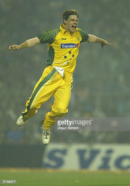Nathan Bracken of Australia celebrates after taking the wicket of Virender Sehwag of India during the TVS Triangular One Day Series Final between...
