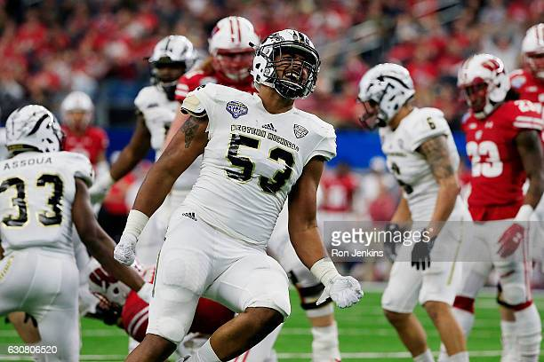 Nathan Braster of the Western Michigan Broncos celebrates a sack in the third quarter during the 81st Goodyear Cotton Bowl Classic between Western...