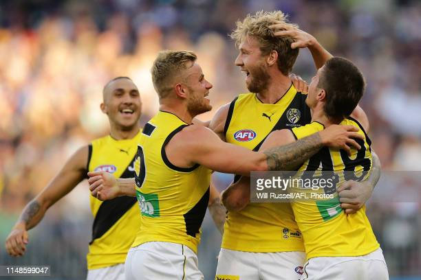 Nathan Broad of the Tigers celebrates after scoring a goal during the round eight AFL match between the Fremantle Dockers and the Richmond Tigers at...