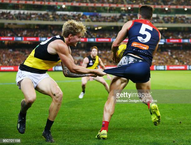Nathan Broad of the Tigers tackles Christian Petracca of the Demons during the 2018 AFL round five match between the Melbourne Demons and the...