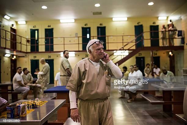 Nathan Brown a prisoner at Rhode Island's John J Moran Medium Security Prison walks through his cell block on December 10 2013 in Cranston Rhode...