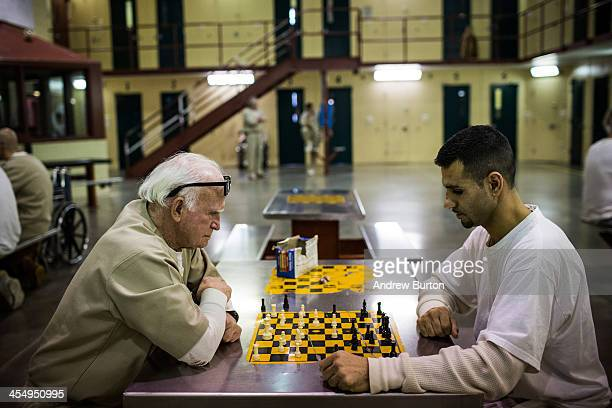 Nathan Brown a prisoner at Rhode Island's John J Moran Medium Security Prison plays chess against another inmate on December 10 2013 in Cranston...