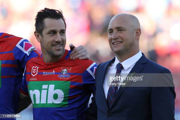 Nathan Brown coach of the Newcastle Knights with Mitchell Pearce of the Newcastle Knights during the round 7 NRL match between the Newcastle Knights...