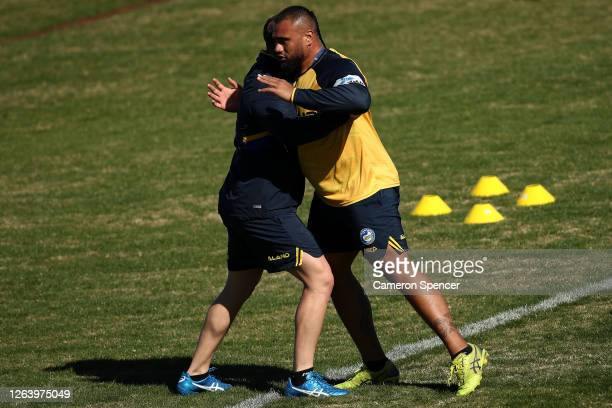 Nathan Brown of the Eels and Junior Paulo of the Eels perform drills during a Parramatta Eels NRL training session at Kellyville Park on August 05...