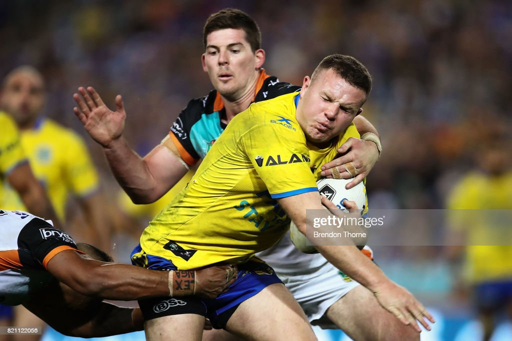 Nathan Brown of the Eels is tackled by the Tigers defence during the round 20 NRL match between the Wests Tigers and the Parramatta Eels at ANZ Stadium on July 23, 2017 in Sydney, Australia.