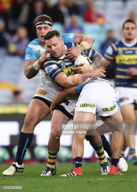 Nathan Brown of the Eels is tackled by the Titans defence during the round 21 NRL match between the Parramatta Eels and the Gold Coast Titans at ANZ...