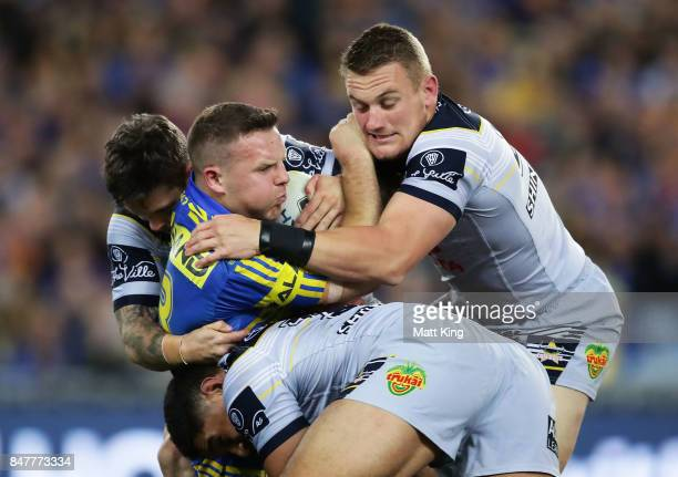 Nathan Brown of the Eels is tackled during the NRL Semi Final match between the Parramatta Eels and the North Queensland Cowboys at ANZ Stadium on...