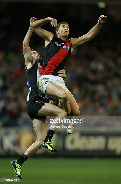 Nathan Brown of the Magpies and Tom Bellchambers of the Bombers contest for the ball during the round 19 AFL match between the Collingwood Magpies...