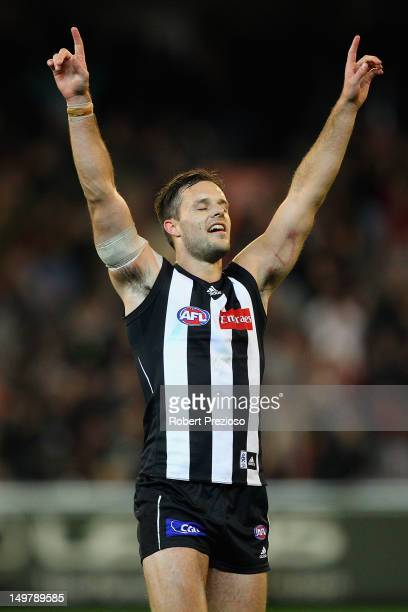 Nathan Brown of the Magpies celebrates a win during the round 19 AFL match between the Collingwood Magpies and the St Kilda Saints at the Melbourne...