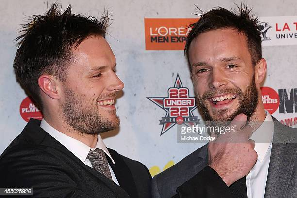 Nathan Brown of the Magpies grabs the beard of brother Mitchell Brown of the Eagles arrives at the 2014 AFL Players MVP Awards at Shed 14 on...