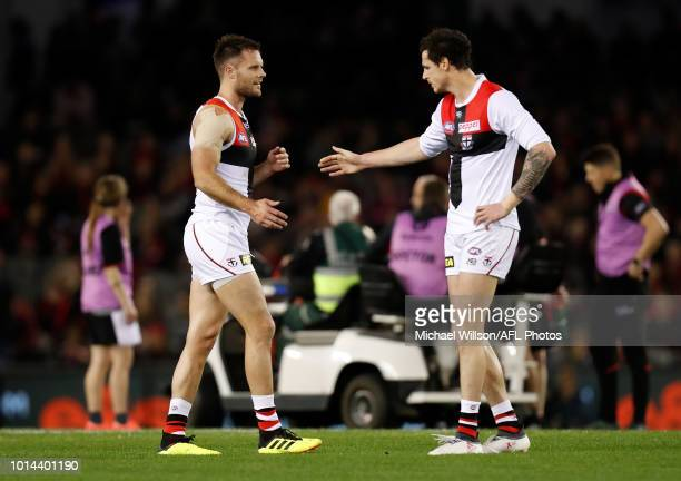 Nathan Brown of the Saints and Jake Carlisle of the Saints looks on as Adam Saad of the Bombers is stretchered from the field during the 2018 AFL...