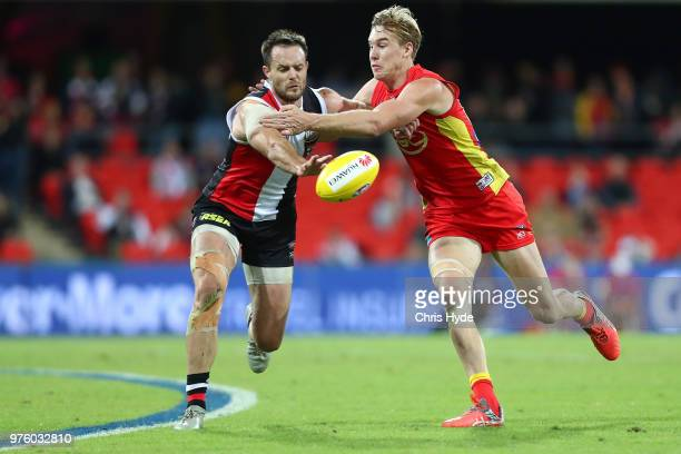 Nathan Brown of the Saints and Tom Lynch of the Suns compete for the ball during the round 13 AFL match between the Gold Coast Suns and the St Kilda...