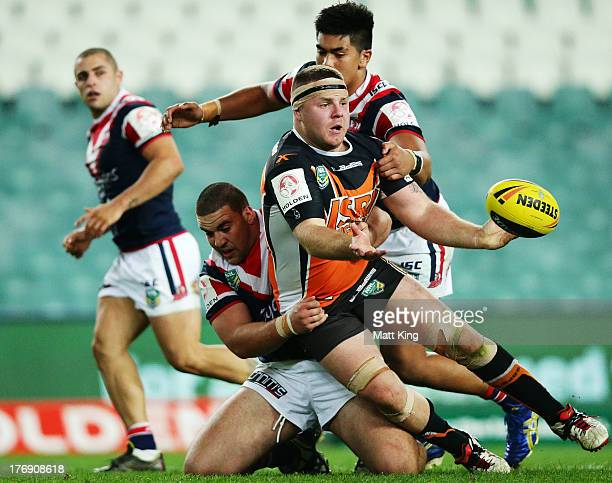Nathan Brown of the Tigers offloads in a tackle during the round 23 Holden Cup match between the Wests Tigers and the Sydney Roosters at Allianz...